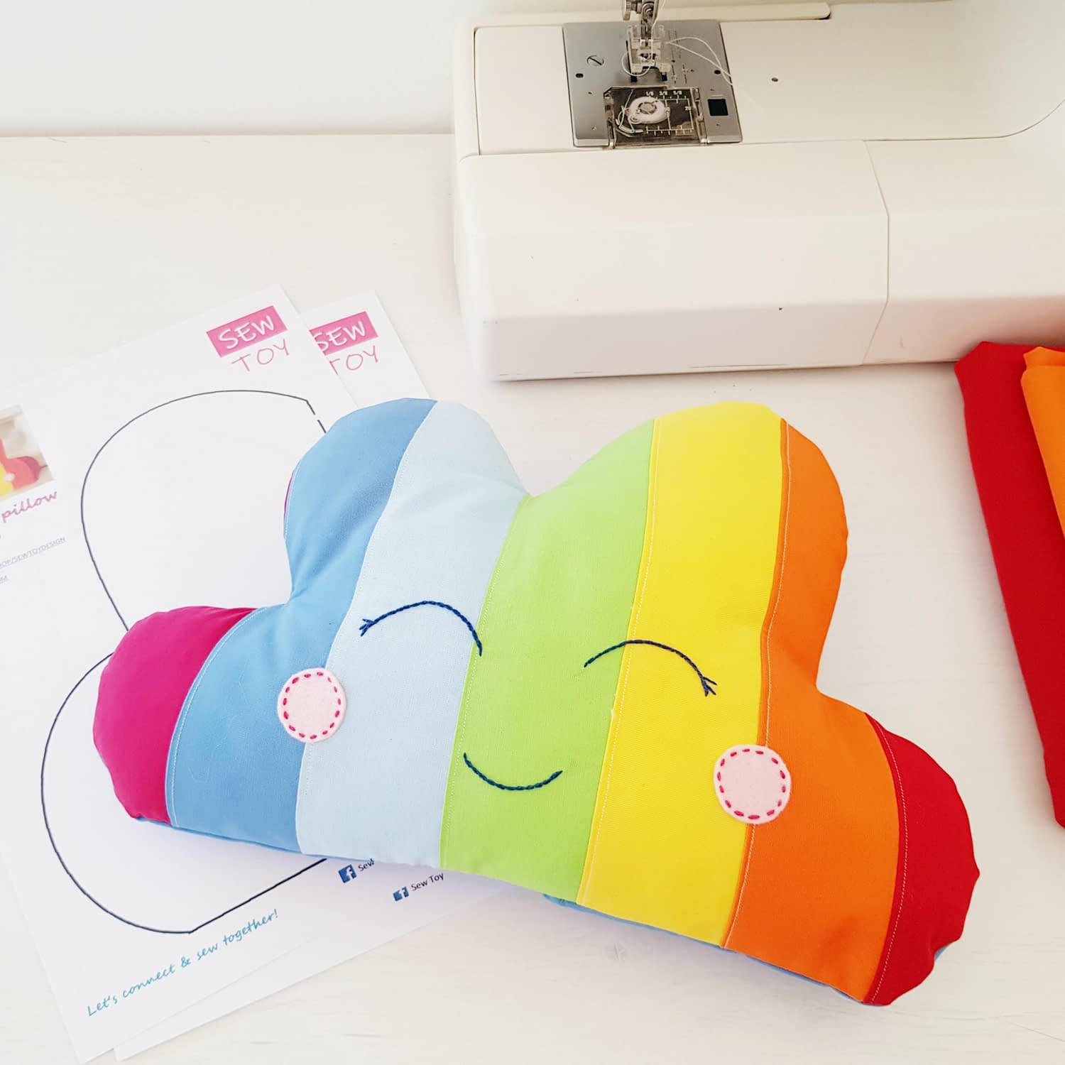 Rainbow pillow cloud sewing pattern for beginners with a smiley face
